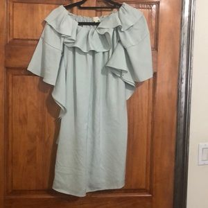 Mint colored flowey dress with ruffle top.
